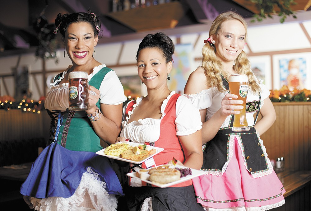 Oktoberfest runs all month at Das Stein Haus, where you'll be greeted by (left to right) Nicole Garner, Stefanie Cordero and Alyse Honnold. - YOUNG KWAK