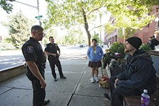 "On a downtown emphasis patrol, officers talk with with ""Ace,"" right, and Annette Carter near the Olive Garden. - YOUNG KWAK"
