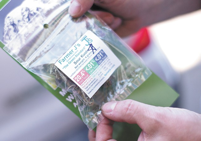 One of the first baggies of marijuana sold legally in Spokane, at Green Leaf on July 8. - YOUNG KWAK