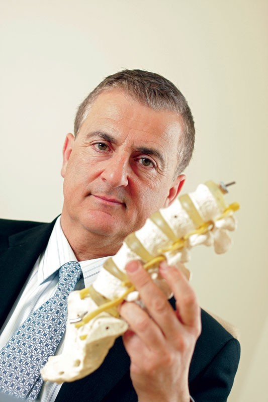 Orthopedic surgeon Antoine Tohmeh is testing new methods for lower back surgery. - YOUNG KWAK