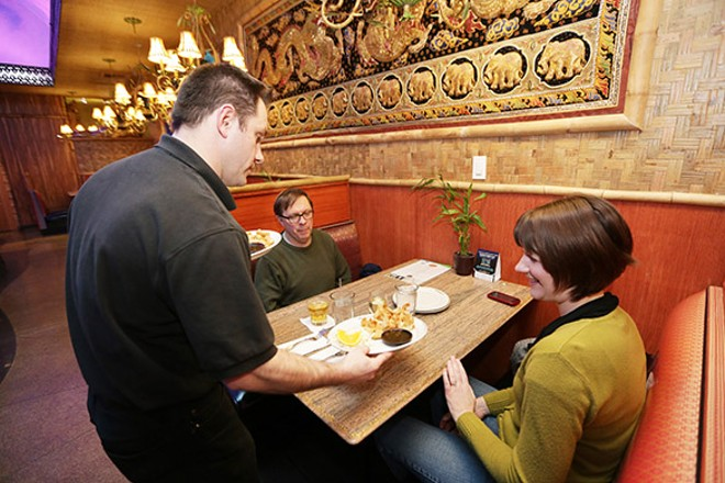 Amber Waldref and her husband are served their appetizers by general manager Warren Wycoff at Thai Bamboo last Friday. - YOUNG KWAK