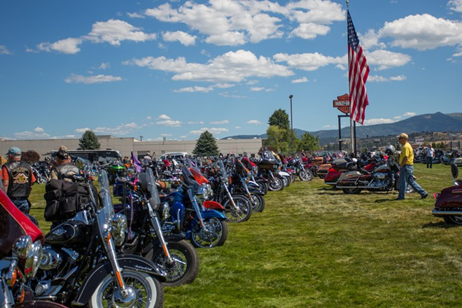 Over 1,000 motorcycles sit on the grass at Lone Wolf Harley Davidson while their owners enjoy the Pacific Northwest HOG Rally. - MATT WEIGAND