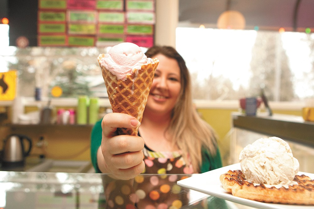 Owner of the Scoop, Jennifer Davis, with a waffle cone of Brain Freeze's strawberry ice cream. - MEGHAN KIRK