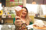 Owner of the Scoop, Jennifer Davis, with a waffle cone of Brain Freeze's strawberry ice cream.