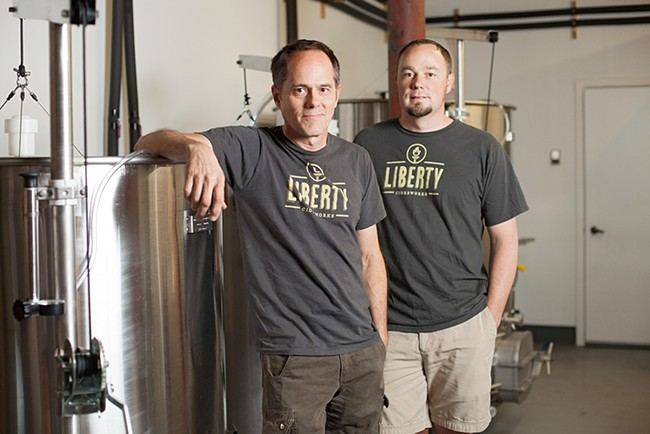 Owners Rick Hastings, left, and Austin Dickey opened the production side of Liberty Ciderworks last summer. - YOUNG KWAK