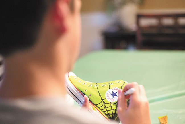 Painted shoes from Art Matters Spokane's youth project are to be exhibited this weekend at Luxe Ballroom. - YOUNG KWAK