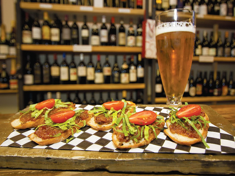 Pair a glass of wine or beer with Vintage Vines\' bacon jam bruschetta. - JOE KONEK