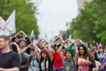 Parade participants hold up hearts as they reach the end of the route.