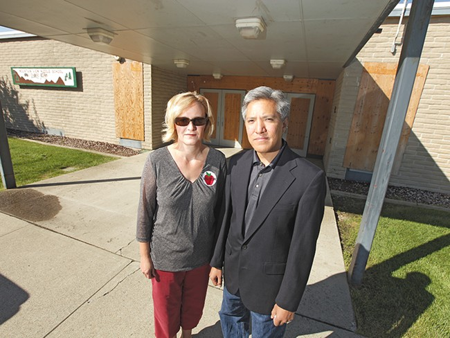 Parents Mindy Stewart and her husband, Dan, outside a boarded-up Mountain View Middle School. - YOUNG KWAK