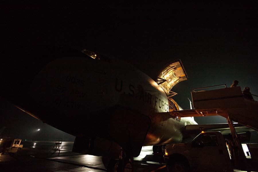 Passengers disembark a KC-135 at the Transit Center at Manas, Kyrgyzstan. - YOUNG KWAK
