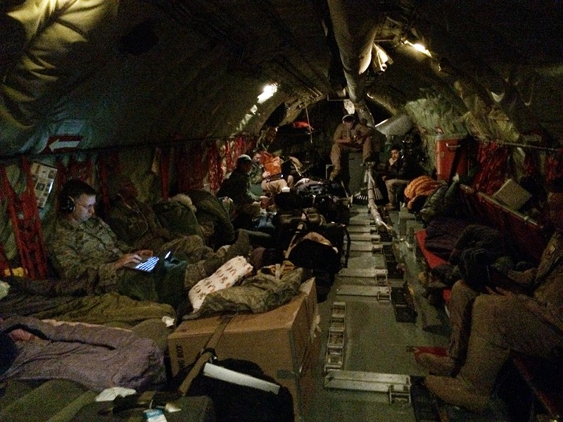 Passengers rest in a KC-135 flying from Fairchild Air Force Base. - YOUNG KWAK