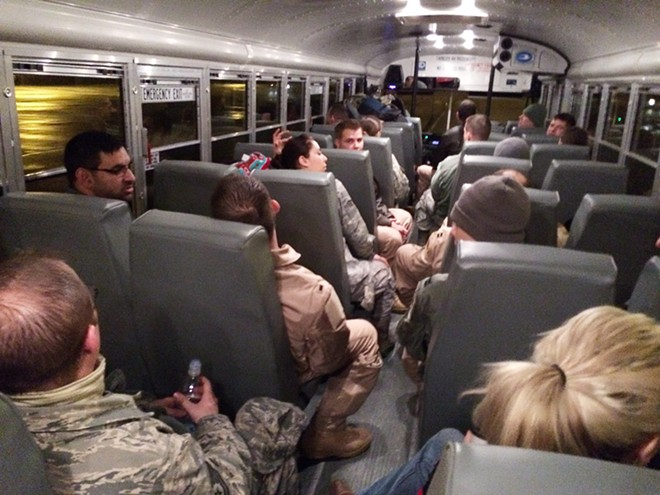 Passengers take a bus after an overnight stay at RAF Lakenheath to a KC-135 flying from Fairchild Air Force Base to the Transit Center at Manas, Kyrgyzstan. - YOUNG KWAK