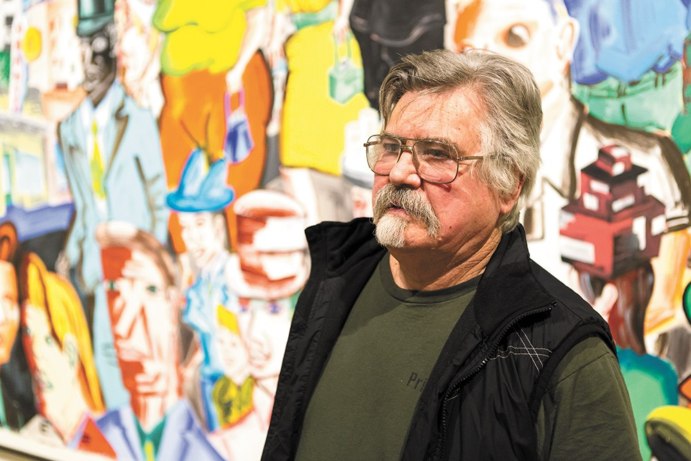 Patrick Siler in front of his exhibit at the MAC. - STEPHEN SCHLANGE
