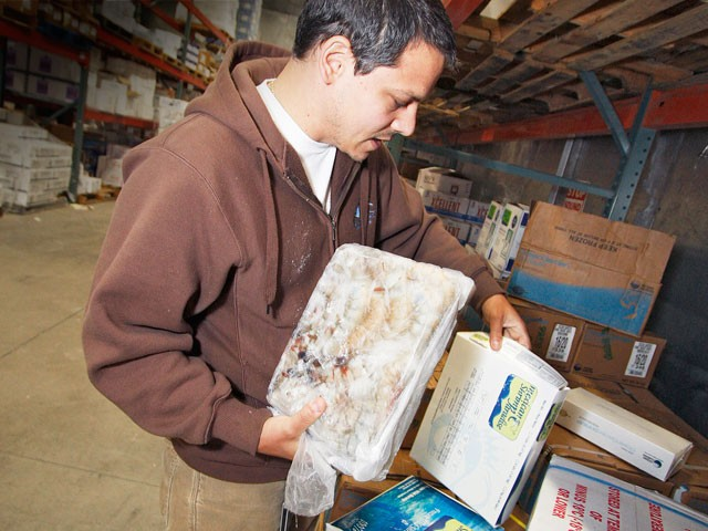 Phil Lanzone, of Northstar Seafoods in Spokane, says shrimp supplies are quickly dwindling. - YOUNG KWAK