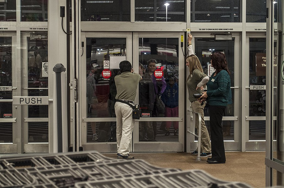Nathan Burford, left, unlocks the doors as Kelsey Key, center, and Rose Jordan stand ready. - SARAH WURTZ