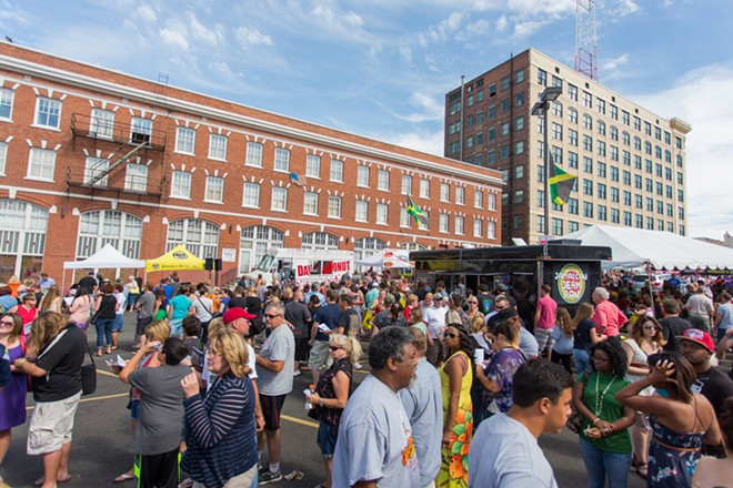 Fifteen hundred people gather in the parking lot just west of Luigi's Restaurant for Food Truck Palooza. - MATT WEIGAND