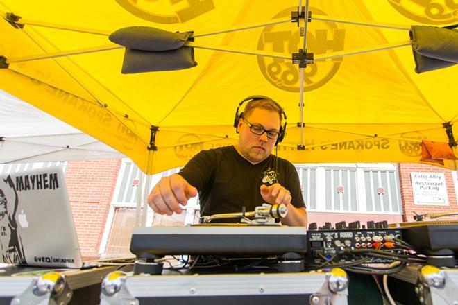 DJ Mayhem, a DJ of 12 years, plays for the crowd at Food Truck Palooza. - MATT WEIGAND
