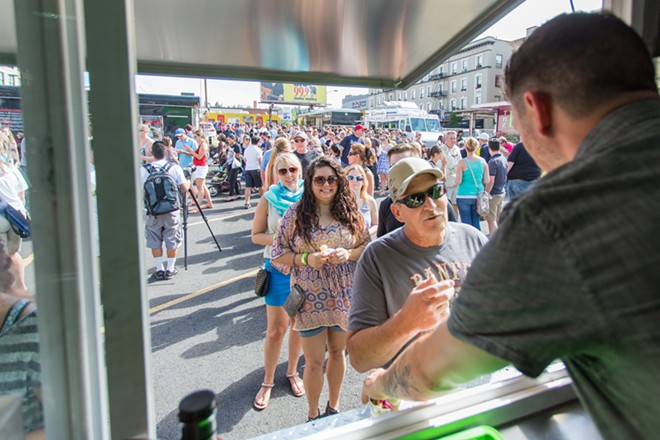 Phil Conway. left, speaks with Steven Kitchnes of Three Ninjas at Food Truck Palooza. - MATT WEIGAND