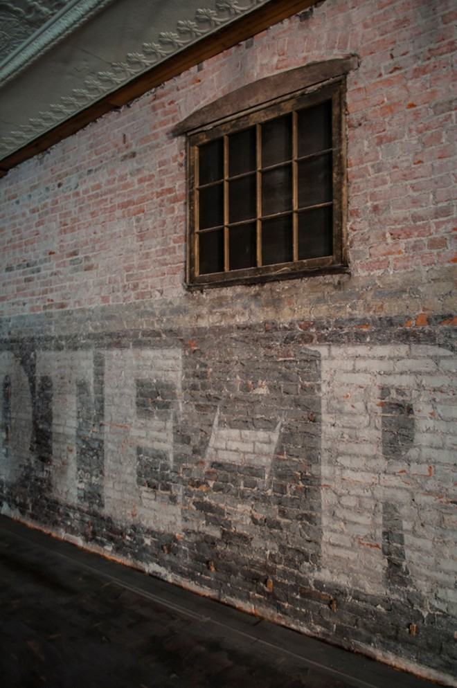 The building once located to the west originally housed a grocery store, and a sign for the business can still be seen on the inside wall of Dania's fourth floor, currently undergoing renovations. - SARAH WURTZ