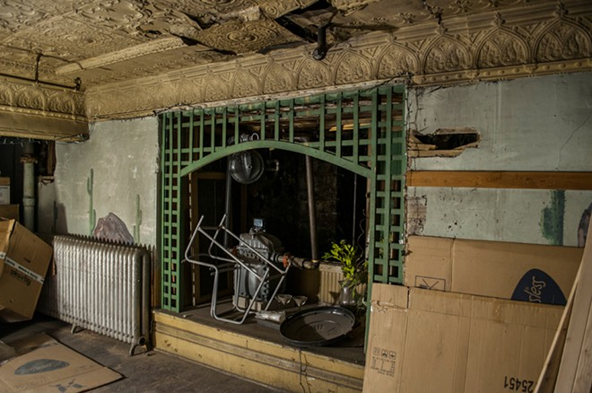 The remains of what once was the Cactus Room, a speakeasy, located in the basement of Dania Furniture. As the building has undergone renovations this year, workers have reported strange things happening here and throughout the rest of the store. - SARAH WURTZ