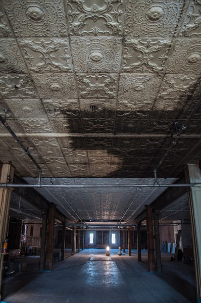 Ongoing renovations call for the tin ceilings to be restored, and the wooden floors on the fourth floor to be refinished. The brick walls with the old grocery store lettering will also remain intact. - SARAH WURTZ
