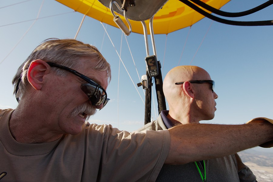 Pilot and Owner Forey Walter, left, points out landmarks to passenger Shane Copenhaver during a hot air balloon ride. - YOUNG KWAK