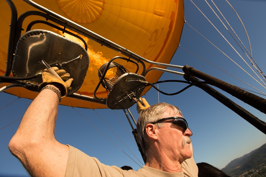 Pilot and Owner Forey Walter turns on the burners during a hot air balloon ride. - YOUNG KWAK