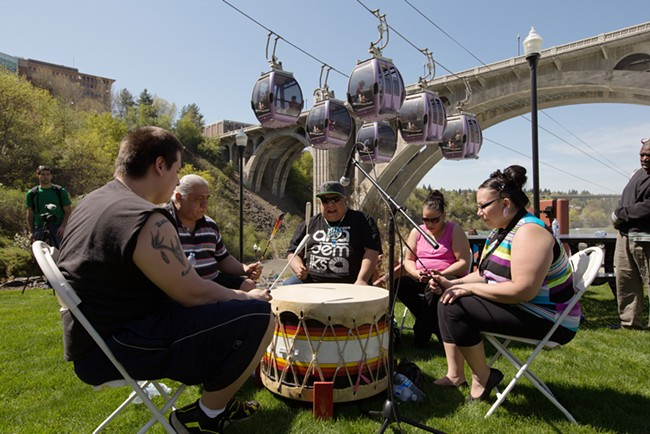 Spokane tribal members (left to right) Robert Corral, Paul Corral, Gabby Corral, Lucille Mathias and Leona Stanger play a drum. - YOUNG KWAK