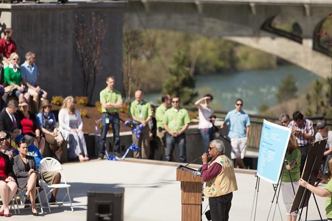 Spokane tribal elder Pat Moses speaks during the dedication. - YOUNG KWAK