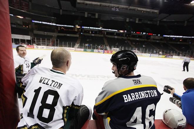 Spokane County Sheriff's Office/Spokane Valley Police Department Detective Jeff Welton (18) and Spokane Police Department Detective Jeff Barrington (46) speak during an overtime style shootout after a hockey game. - YOUNG KWAK