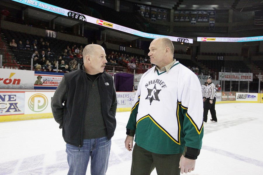 Spokane Police Department Chief Frank Straub, left, and Spokane County Sheriff Ozzie Knezovich speak after a hockey game. - YOUNG KWAK