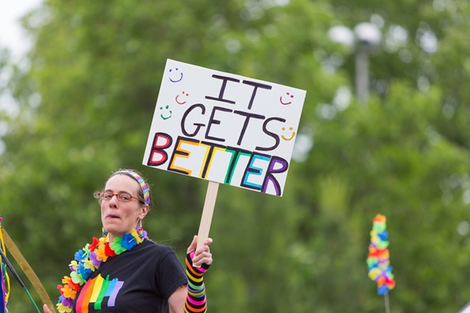A participant holds a sign saying 'It gets Better' at the Pride Parade. - MATT WEIGAND