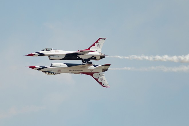 Two U.S. Air Force Thunderbirds Air Demonstration Squadron F-16s perform. - YOUNG KWAK