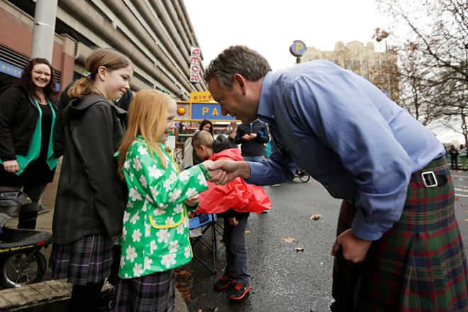Mayor David Condon, right, shakes hands with 7 year old Isabel Webb, center, as her 10 year old sister Brynn watches. - YOUNG KWAK