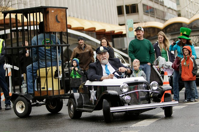 Members of El Katif Shriners drive around in a miniature vehicle. - YOUNG KWAK