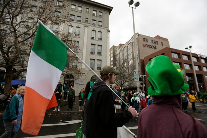 18 year old Zach Bowman, center, carries the flag of Ireland. - YOUNG KWAK
