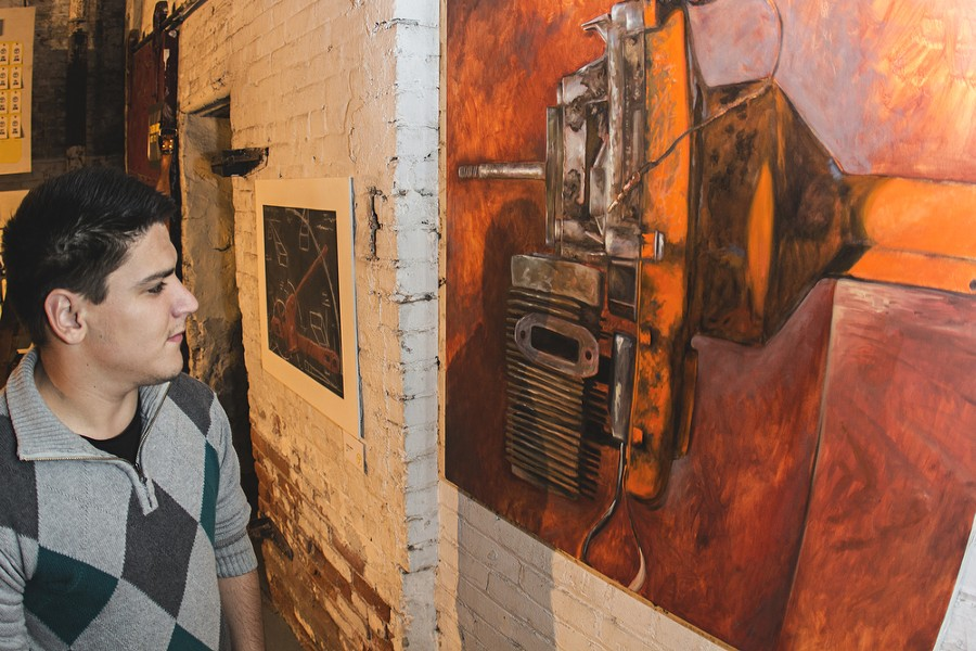 Zac Odom checks out some art. - JOE KONEK