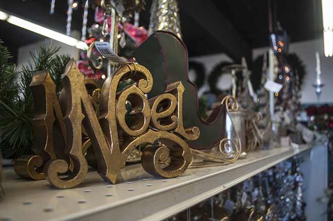 Christmas decorations sit on top of  shelves at the Display House. - SARAH WURTZ