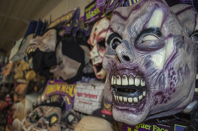 Halloween masks cover a wall in The Display House. - SARAH WURTZ