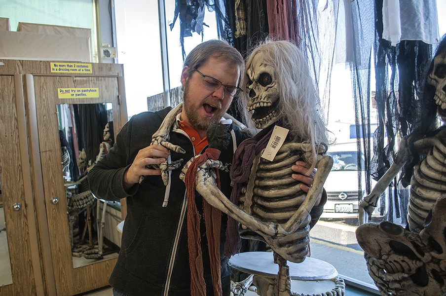 "Nick Jones poses for a photo with one of the store's ""rock 'n' roll"" skeletons. - SARAH WURTZ"