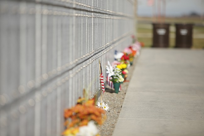 Flowers and flags are left at the Columbarium area at the Washington State Veterans Cemetery. - YOUNG KWAK