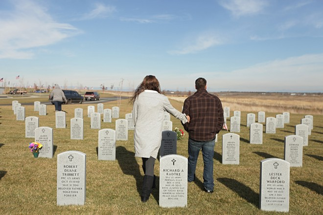 Nate Sullivan, right, and Kerri Davis look for Sullivan's grandfather U.S. Air Force (Ret.) Marvin Delano Averill Sr.'s grave site at the Washington State Veterans Cemetery. - YOUNG KWAK