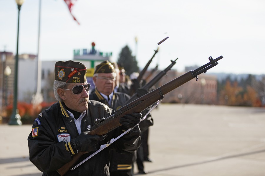 Members of the Spokane Area Veterans Honor Guard, including US Air Force (Ret.) Jack Davis, left, take part in a 21 gum salute during a Veterans Day Ceremony. - YOUNG KWAK