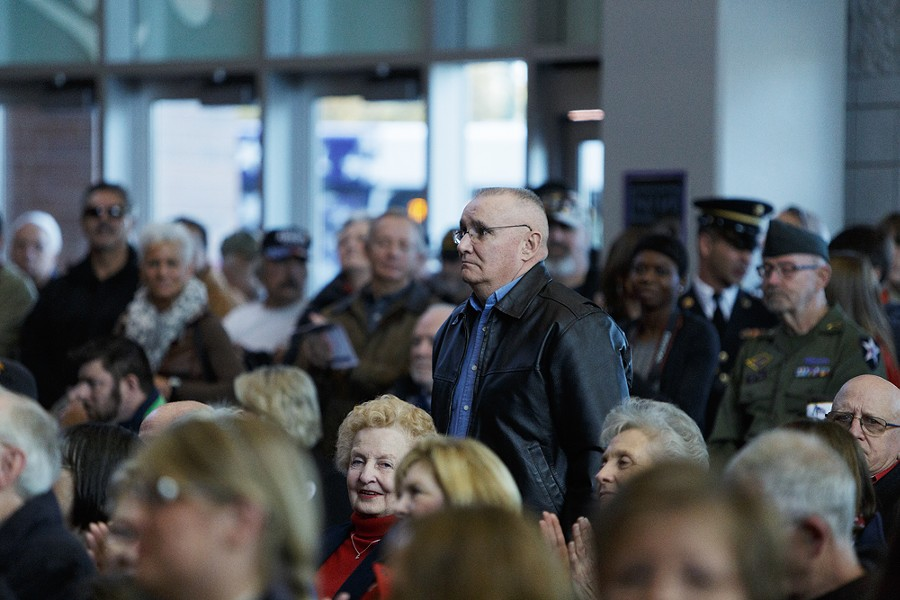 A veteran stands when his service is acknowledged during a Veterans Day Ceremony. - YOUNG KWAK