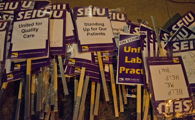 Picket signs outside Valley Hospital. - JACOB JONES