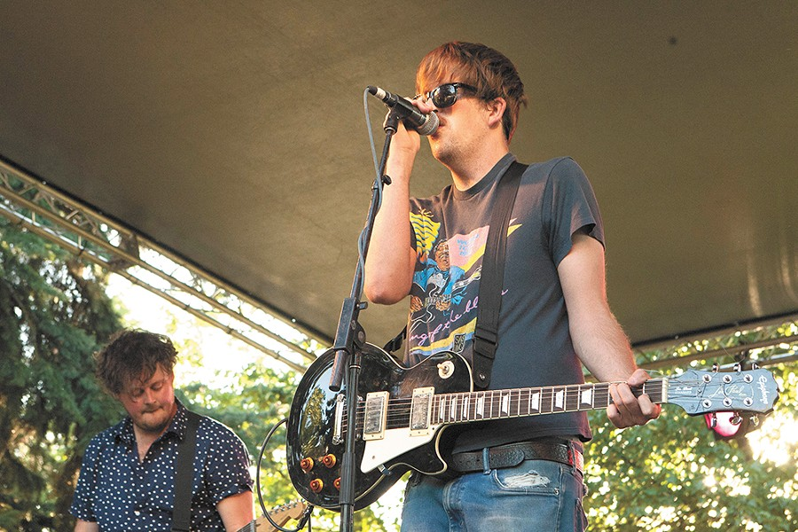 Pine League frontman Tyler Aker, right, and guitarist Scottie Feider at this year's Pig Out in the Park. - MEGHAN KIRK