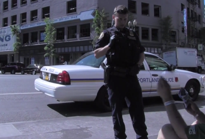 Portland Officer Josh Silverman speaks with a man on the street during a proactive mental health consultation. - PORTLAND POLICE BUREAU