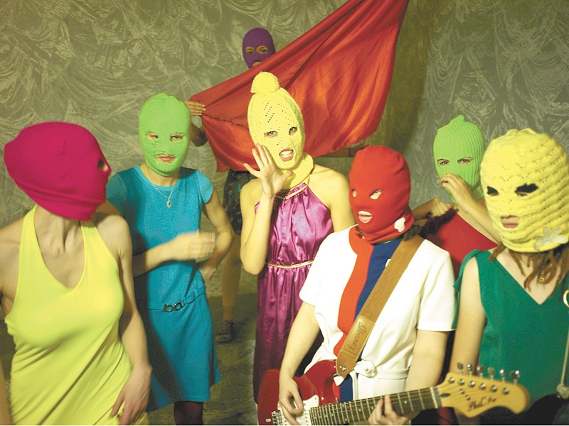 Pussy Riot, in its signature balaclavas
