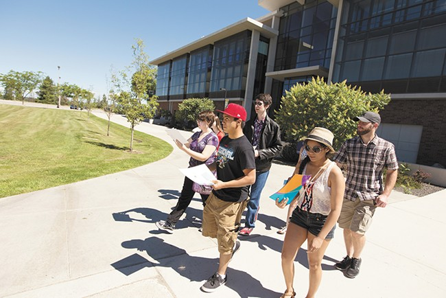 Recent high school graduates participate in a scavenger hunt during a Spokane Public Schools' high-school-to-college-transition event at Spokane Falls Community College. - YOUNG KWAK