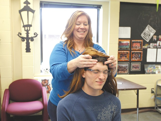Republic High School teacher Liz Bremner dolls up Tyler Weyer, who played Sarah Palin for a school event. - YOUNG KWAK